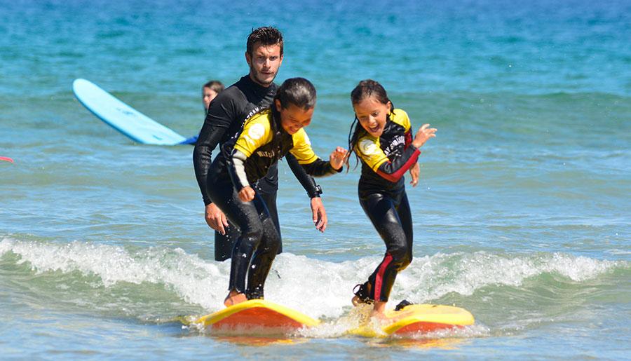 Cursos de surf para menores edad de 4 a 12 años