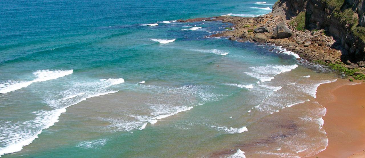 Hacer Surf en la playa de Tablía